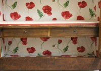Vintage display cupboard with floral interior