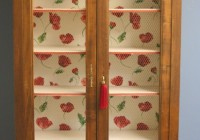 Vintage cupboard with floral interior
